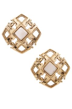 """This pair of authentic Chanel signature """"CC"""" clip-on earrings pay tribute to time-honored Chanel elegance.  In these sumptuous studs, """"CC"""" and Mother of Pearl adorned square silhouettes are rendered in a glamorous gold tone.  The ideal finishing touch, one can use these earrings to transform the basic into breath-taking or complement formal evening attire with ease."""