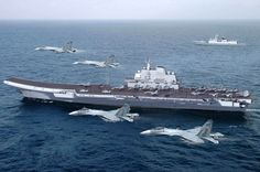Chinese People's Liberation Army Navy (PLAN)  aircraft carrier Liaoning and J-15 Flying Shark carrier-based fighter flyby illustration.