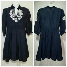"""Bohemia inspired dress NWT Brand new with tags Navy blue dress with white embroidering at neckline and on sides of sleeves. Semi elastic threading through waist and at the end of each sleeve   65% cotton 35%polyester. length is approx 32"""" long  bust is approx 18"""" seam to seam Dresses"""