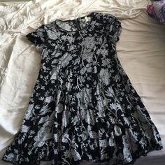 Black and white floral dress Black flowy dress with white flower design. Uneven angular bottom hem with black fringed fabric detail. Back top zipper closure. Been worn once, in perfect condition. Silence and Noise brand. Urban Outfitters Dresses Midi