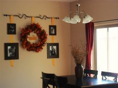 Fall decorations on a wall.  Great idea!
