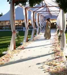 walkway from one tent to another at an outdoor wedding