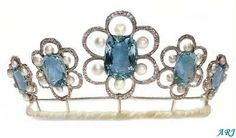 The Kent Aquamarine Tiara: The new version of the tiara is without the bandeau setting. The ovals were removed but the flower-setting within remain: they are now arranged within an openwork surrounds, not unlike a button-tiara setting. The Duchess of Kent was pictured wearing this tiara on just a couple of occasions so it is not even certain the tiara does in fact belong to her (it might have been just a loan).