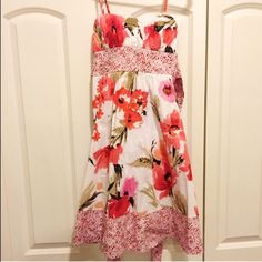 Floral dress. Floral dress with sash below the busy that ties behind the back. Zipper in the back. Only worn once. Hits at the knees. Padded bust. My Michelle Dresses Midi