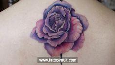Violet and pink colour flower tattoo on upper back