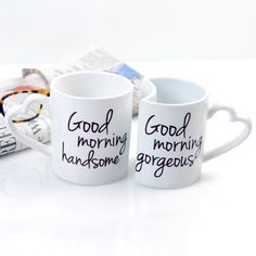"""Good Morning Coffee Mugs (Set of 2) Start each day off right with our cleverly designed Good Morning Coffee Mugs. Featuring the greetings """"Good Morning Gorgeous"""" and, on her cup, """"Good Morning Beautiful"""", it will be tough to have a bad day. The interlocking ceramic stoneware mugs with heart-shaped handles hold up to 10 oz. They are both dishwasher and microwave safe and are sold in a set of 2. They make a perfect gift for the newlyweds!"""