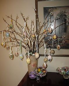 An egg tree made with silk flower branches & real hand-painted eggs