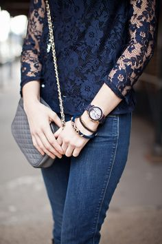 navy lace top, bracelets, watch, and bag