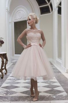 Mooshki Lily - A super cute tea length gown in blush with daring low back. Too gorgeous for words, blush satin overlaid in champagne tulle and hand dyed guipure lace to the bodice. Sheer illusion neckline and sleeves for a delicate touch while the low V back adds drama.