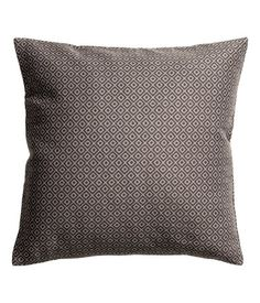 Jacquard-weave cushion cover with concealed zip at lower edge. Size 20 x 20 in.