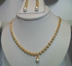 Shop American Diamonds With Pearls Set (artificial Jewellery) by Dimple Collections online. Largest collection of Latest Necklaces online. Gold Jewelry Simple, Gold Wedding Jewelry, Bridal Jewelry, Beaded Jewelry, Silver Jewelry, Gold Earrings Designs, Gold Jewellery Design, Necklace Designs, Gold Designs
