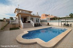 Property ref: 3949 Beautiful detached villa with 500m2 flat plot and private pool for sale in Urb. La Marina. This property comprises of a large terrace, living room, dining area, kitchen, 3 bedrooms, 2 bathrooms and a large sun terrace. The property is situated in a quiet yet central location, has marble stairs, granite work tops, fitted mirrored wardrobes, barbecue, exterior shower and is being sold fully furnished. Price: 235.000€