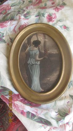REDUCED Antique Gold Metal Framed Victorian Lady Holding Flowers Outdoor Landscape Trees Print Oval Period Picture Frame by treasuretrovemarket on Etsy