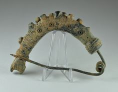 Luristan bronze brooch Luristan fibula, 8th-7th century B.C. semi circular fibula shaped like an arm ornamented with lobes with the end clasping the tip of the pin. This early iranian type was probably intoduced from Anatolia (Phrygia), 7.9 cm long. Private collection