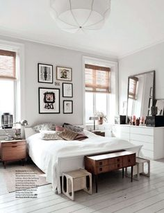 Love the neutral colors of white, wood, black in this serene, chic bedroom. #interiordesign