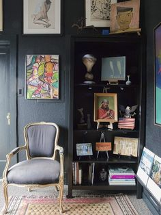 Michele's gallery is only about 300 sq ft! She's made the most of the space, painting the walls an inky and dramatic black.
