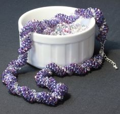 Dutch Spiral Necklace in Amethyst £24. https://folksy.com/items/6636155-Dutch-Spiral-Necklace-in-Amethyst This piece was inspired by a tutorial from Cara Landry at Simple Bead Patterns, Dragonfly Lane who give permission for items made from their patterns to be sold.