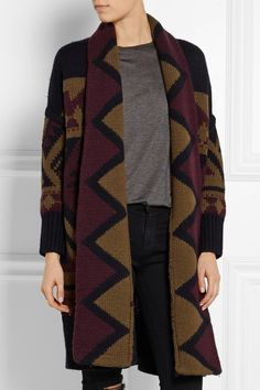 BURBERRY BRIT Intarsia wool cardigan The geometric intarsia on Burberry Brit's cardigan is influenced by British decorative arts. It's knitted from heavyweight wool and the rich palette of midnight-blue, burgundy and brown will work with all your favorite winter staples. Wear it with boots