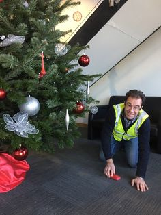 Jon - Tidying up after decorating this tree with Silver & Red decorations