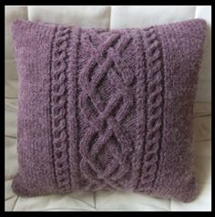 Plum cable knit pillow.                                                                                                                                                                                 More