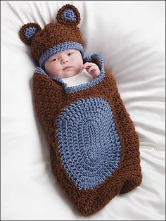 Leaflet includes four cocoons with matching hats, plus a one-piece hooded cocoon. Made using sport, worsted or bulky weight yarns, each set is perfect for a newborn to 3 months.