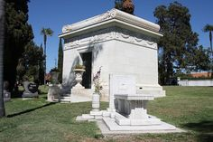 The final resting place of Marion Davies at Hollywood Forever Cemetery. She is interred inside the Douras (Her original last name) family mausoleum in the background. Marion is here with her parents, daughter Patricia (with Hearst), and son in law actor Arthur Lake. The bench in the foreground marks the grave of actor Tyrone Power. Famous Tombstones, Hollywood Forever Cemetery, Marion Davies, Travelers Rest, Church Pictures, Famous Graves, Cemetery Art, Feature Film, Old Hollywood