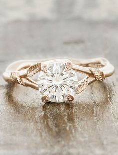 Pembroke - rose gold nature-inspired engagement ring with leaf accents** but in white gold **