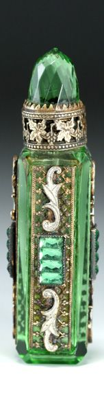 c.1930s Czechoslovakian Green Cut Glass Enamelled & Jewelled Jeweled Scent Perfume Purse Bottle. An elegant four sided tower shape green cut glass scent bottle with elaborate facet cut capstone and bevelled edges. The bottle features a jewelled and enamelled filigree strip applied to each side. $360