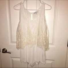 White lace romper. Romper. White. Lace flowy detail on top. Sleeveless. Fully lined. 100% rayon. Large. Great condition - only worn once! Charlotte Russe Pants Jumpsuits & Rompers