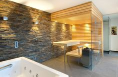 spacious and luxurious bathroom with walk in sauna and white tub and stone wall accent Portable Sauna, Bath Detox, Steam Sauna, Sauna Room, Bathroom Design Inspiration, Teen Girl Bedrooms, Swimming Pools, Bathtub, Architecture