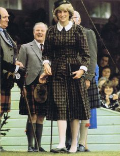 September 4, 1982: Princess Diana pictured attending the annual Braemar Games in Scotland during the Royal family's summer holiday at Balmoral. Prince Charles was pictured tenderly kissing Princess Diana on the hand as they sat and watched the competitors taking part in the events. This page came from an October 1982 issue of Royalty magazine.