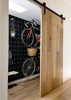 17 Amazing Bike Storage Ideas You Just Have To See Amazing space-saving cool bike storage ideas for small room and apartments. These indoor bike storage solutions are for pedal pushers who can't part with their bike. Indoor Bike Storage, Bicycle Storage, Bike Storage House, Bike Storage Cupboard, Bike Storage Living Room, Bike Storage Inside, Home Bike Rack, Bike Storage Design, Indoor Bike Rack