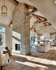Brick/stone statement fireplace, wood beams, unique light fixtures throughout, open concept, high ceilings.