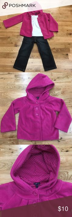 Baby Gap Fleece Jacket Pink hooded fleece jacket by Baby Gap. This jacket features pleating at the chest and three large pink button closures. The sleeves have a bit of flare making it easy to get on. Pretty pink and white material lines the hood for extra comfort and warmth. 100% polyester - machine wash-dry per tag. This jacket has been worn so as with all fleece it shows, but it is still in great condition - no stains or tears. Nice warm jacket for the fall! GAP Jackets & Coats