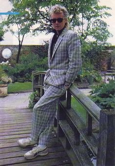 Roger Taylor of Queen. This suit looks like approximately 1984 if I had to guess Queen Drummer, Drummer Boy, Arena Rock, Roger Taylor Queen, Ben Hardy, We Will Rock You, Somebody To Love, British Rock, Queen Freddie Mercury