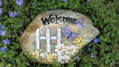 Painted Welcome rock with picket fence daisies by MyPaintedSwan