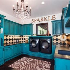 What a cute laundry room! Almost makes you happy to do laundry.