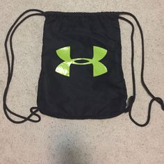 787015c964 Black And Green Under Armour Draw String Backpack. Under Armour Women