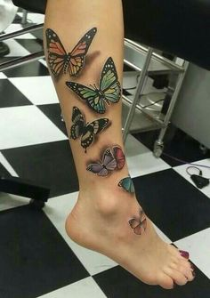 Beautiful butterfly design with shadow 3-D effect.  this tattoo with some colorful flowers
