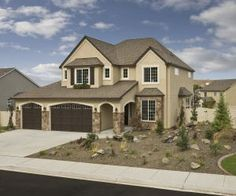 I like this exterior color scheme for stucco and stone a lot.  Garage will not have windows.