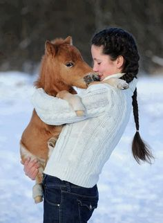 Just a girl holding a pony
