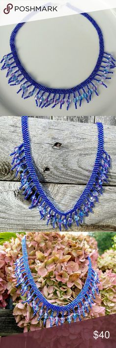 """Handmade, hand-sewn blue choker with czech beads This is a handmade beaded choker made with irridescent blue and purple seed beads. The fringe is also made with irridescent seed beads and purple, blue and pink Czech glass beads. This was made using a technique called brick stitch. It has a lobster claw clasp and is 18"""" in length. Jewelry Necklaces"""