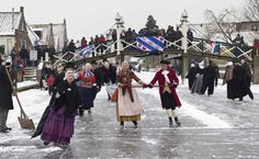 Skaters dressed in traditional Dutch costumes skate on the canal in Hindeloopen January 26, 2013. When the canals and lakes freeze, the Dutch get out their skates and venture out on the ice. In Friesland, skaters dressed in traditional costumes gather for a day of ice skating, pole-sledding, and other entertainment on ice. The skaters wear an old-fashioned form of skate with special blades to help them glide across the ice without tiring, and usually skate together in couples or groups