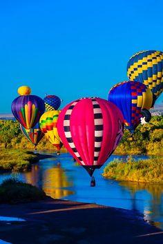 Hot air balloons flying low over the Rio Grande River just after sunrise, Albuquerque International Balloon Fiesta, Albuquerque, New Mexico USA. Le Vent Se Leve, Air Balloon Festival, Albuquerque Balloon Fiesta, New Mexico Usa, Air Balloon Rides, Hot Air Balloons, Air Ballon, Land Of Enchantment, Aerial View