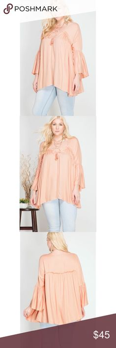 """Plus Size Top 3/4 bell sleeve top with ruffles and tassel.  Peach color.  70% cotton, 30% polyester.  Model is 5'10""""  Price is firm unless bundled. She and Sky Tops"""