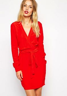 Make a statement in a bright red wrap dress.