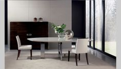 theodores modern dining table.  Like table base and sideboard