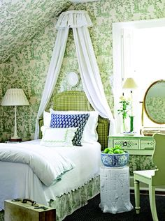 Love this little bedroom with crisp green &!white wallpaper; pretty headboard with sheer curtains - sweet!