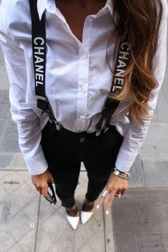 Chanel suspenders with white blouse