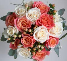 bridesmaid bouquet featuring peach miss piggy and cream vendela roses